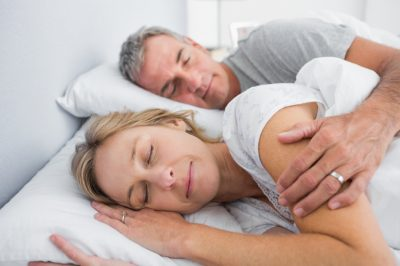 sleeping and spooning in bed in bedroom at home
