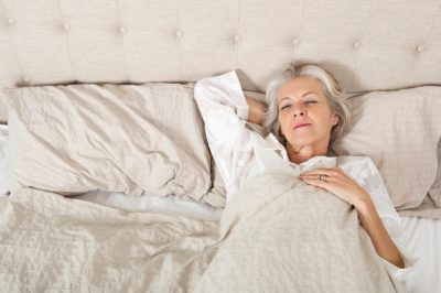 Senior woman sleeping in bed